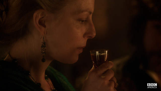 Morehouse offers Elizabeth a drink with a splash of opium to calm her nerves.