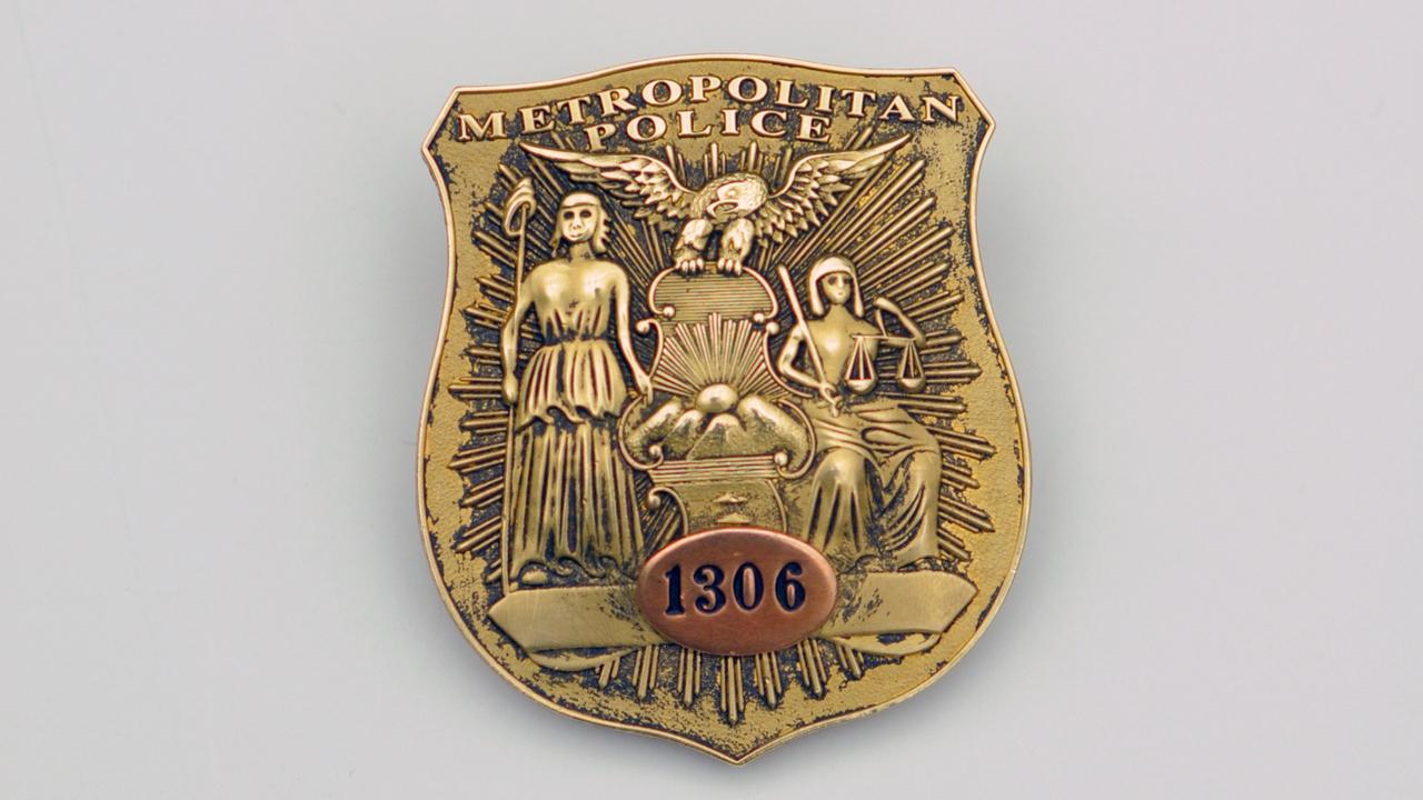 A Metropolitan Police badge.