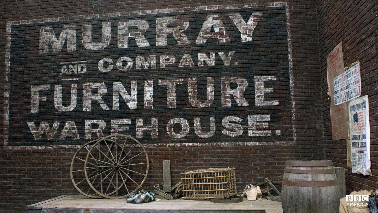 Hand-painted brick wall advertisements.