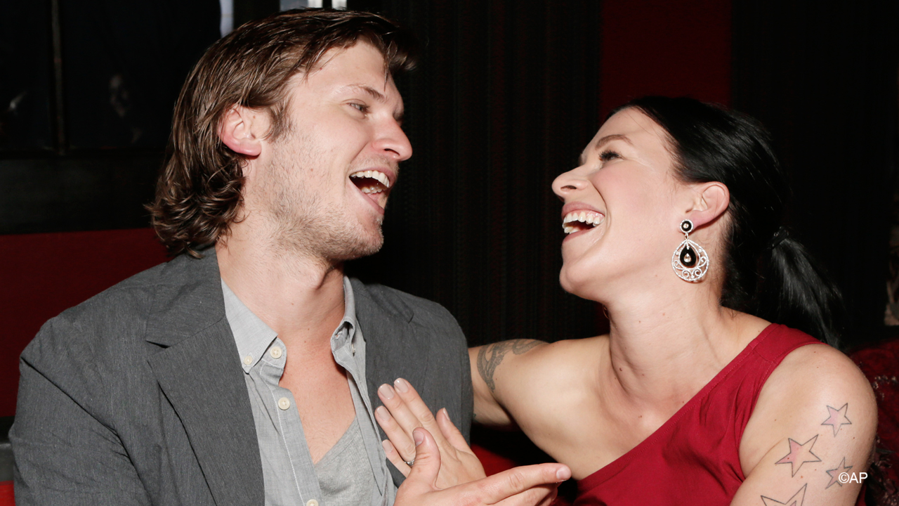 Guess we had to be there, right Tom? 'Copper' co-stars Tom Weston-Jones and Franka Potente work it for the cameras.
