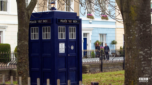 Amy and Rory watch the TARDIS as it disappears.