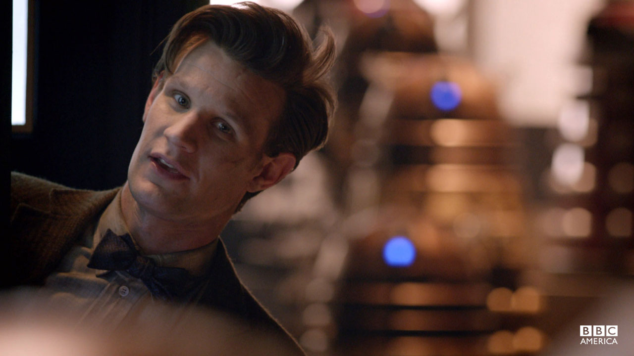 The Doctor peeks out of the TARDIS