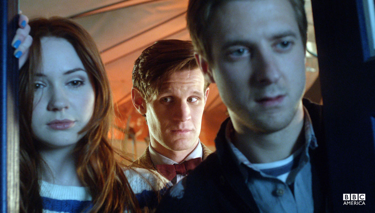 Amy, Rory, and the Doctor gaze out of the TARDIS.