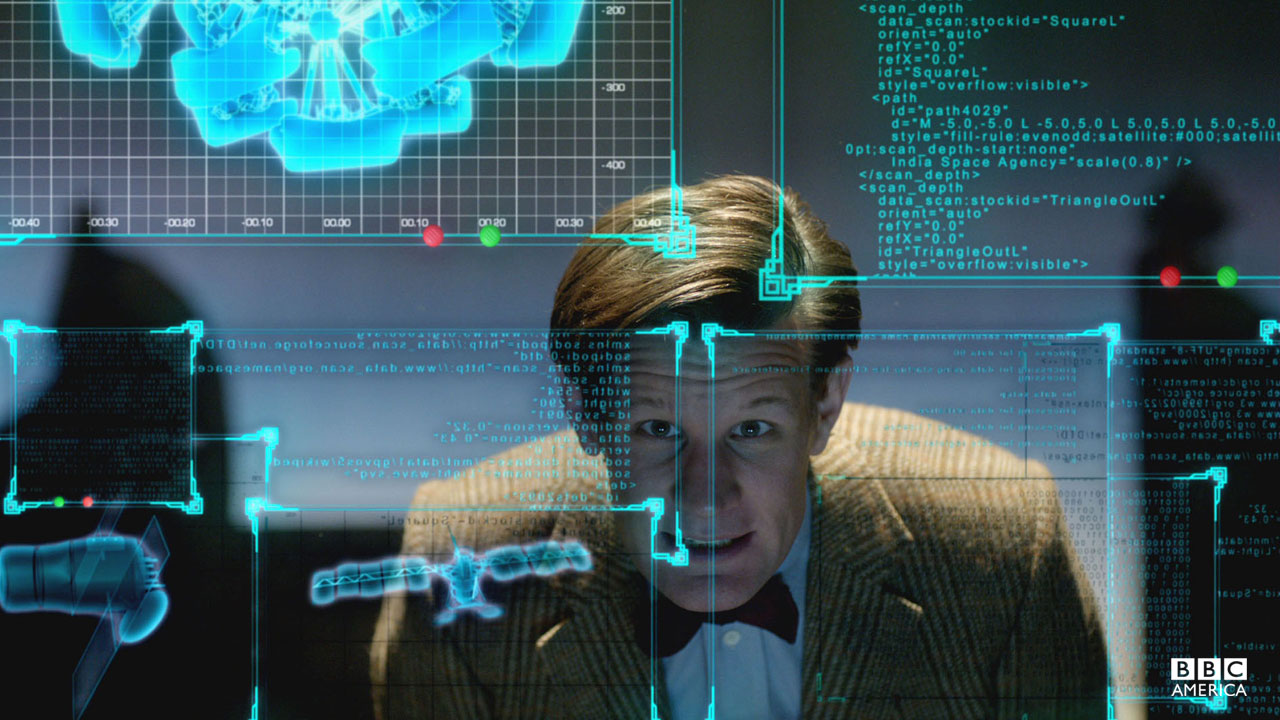 The Doctor stares at a computer screen.