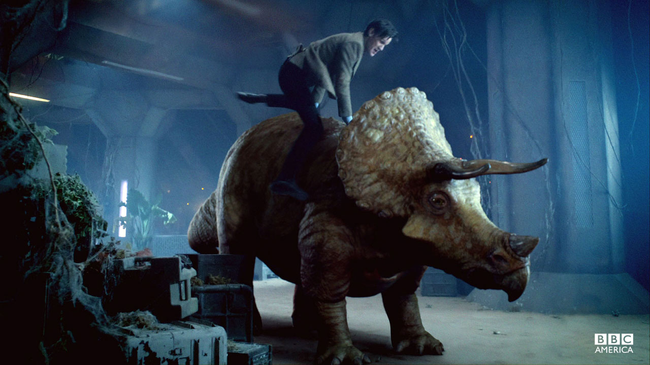 The Doctor hops onto a Dinosaur for a ride.