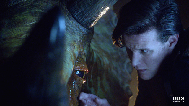 The Doctor tends to a triceratops.