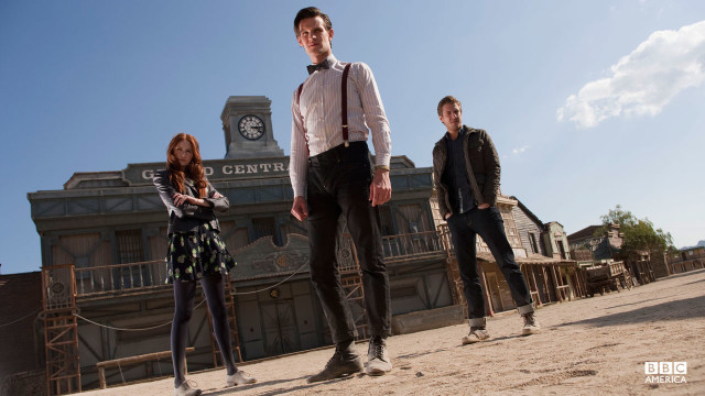 The Doctor, Amy, and Rory standing in the middle of Mercy.