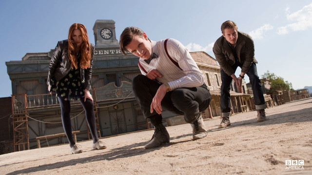 The Doctor, Amy, and Rory staring intently.