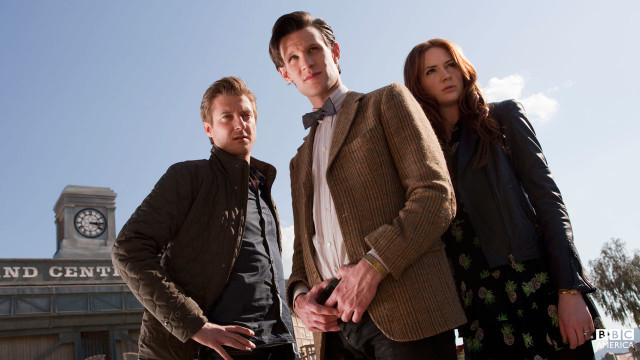 The Doctor, Amy, and Rory stand together.