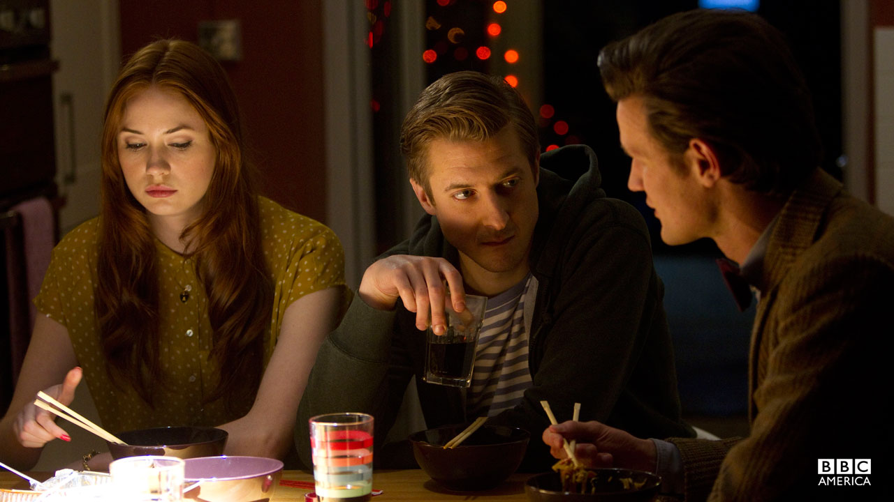 The Doctor, Amy, and Rory talk over a meal.