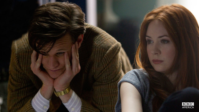 The Doctor sits frustrated.