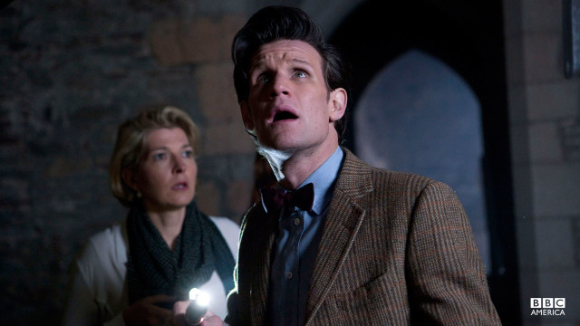 The Doctor looks up at something.