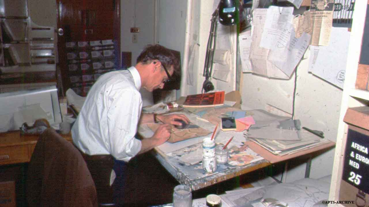 A graphic artist preparing visuals to illustrate a news story.