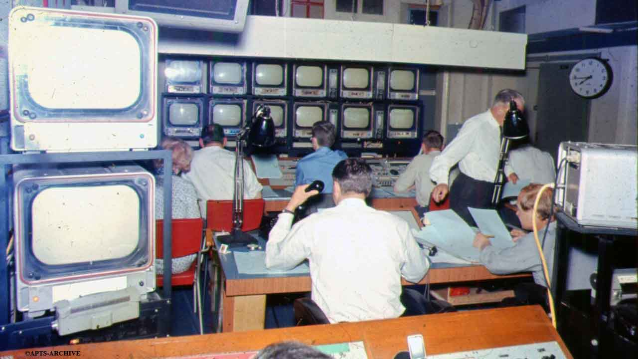 Studio B Control Gallery – opposite view of above photograph. The bank of monitor screens are clearly visible in the background, to which all those in the control room watch constantly. The control room engineer is sitting in the immediate foreground.