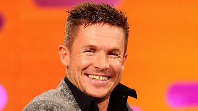 Austrian skydiver Felix Baumgartner, who in October 2012 wowed the world record books with his daredevil jump to Earth, making him the first human to break the sound barrier outside of a vehicle, smiles for the camera.