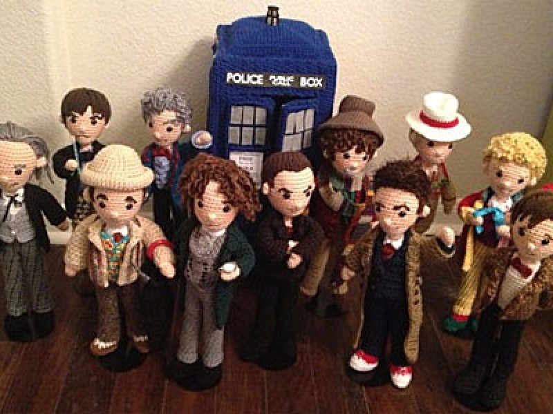 Eleven crocheted Doctors and a crocheted TARDIS