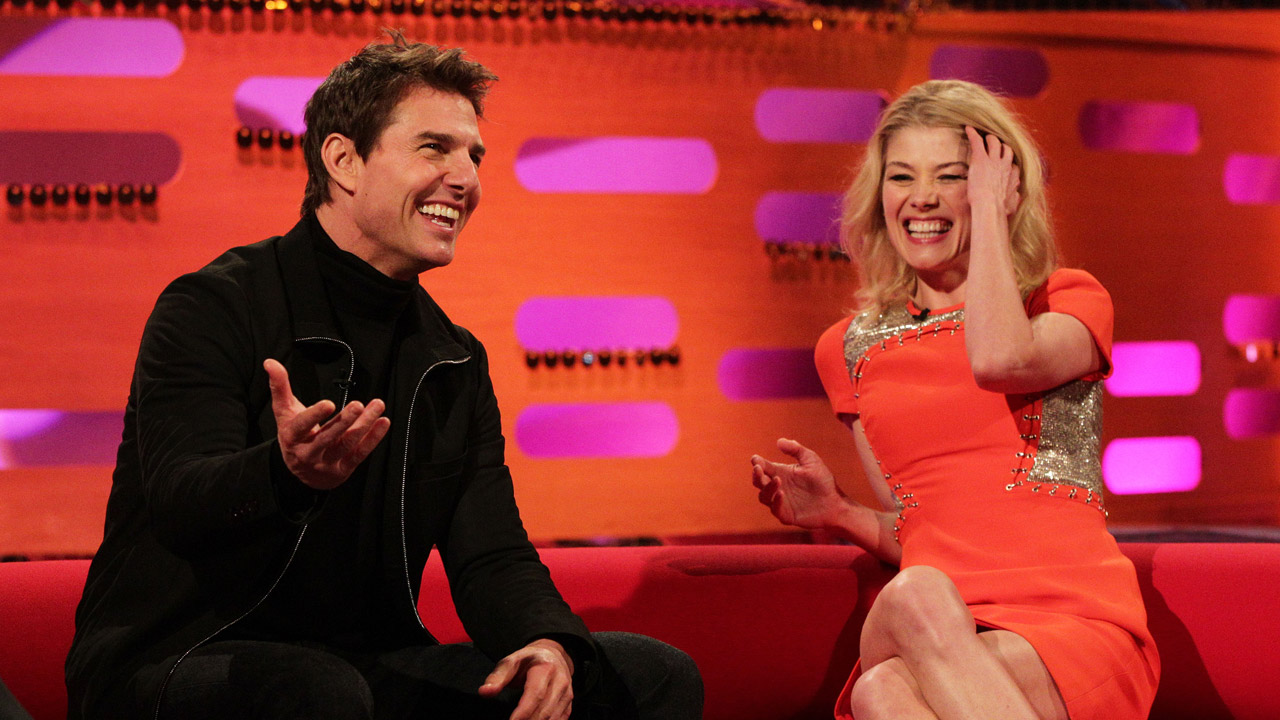 'Jack Reacher' co-stars, Tom Cruise and Rosamund Pike, share a laugh.