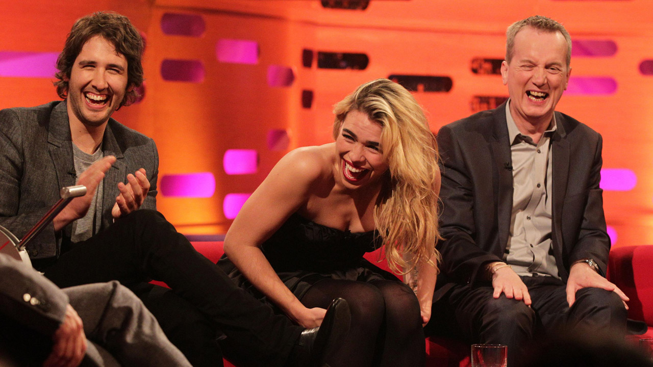 Josh Groban, Billie Piper, and Frank Skinner break down laughing.