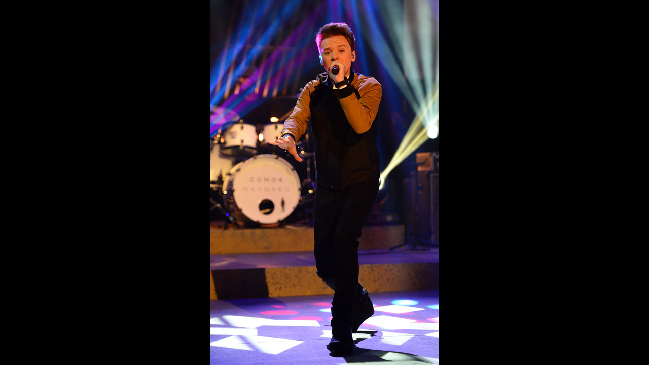 Conor Maynard sings on stage.