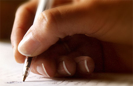 A hand, writing