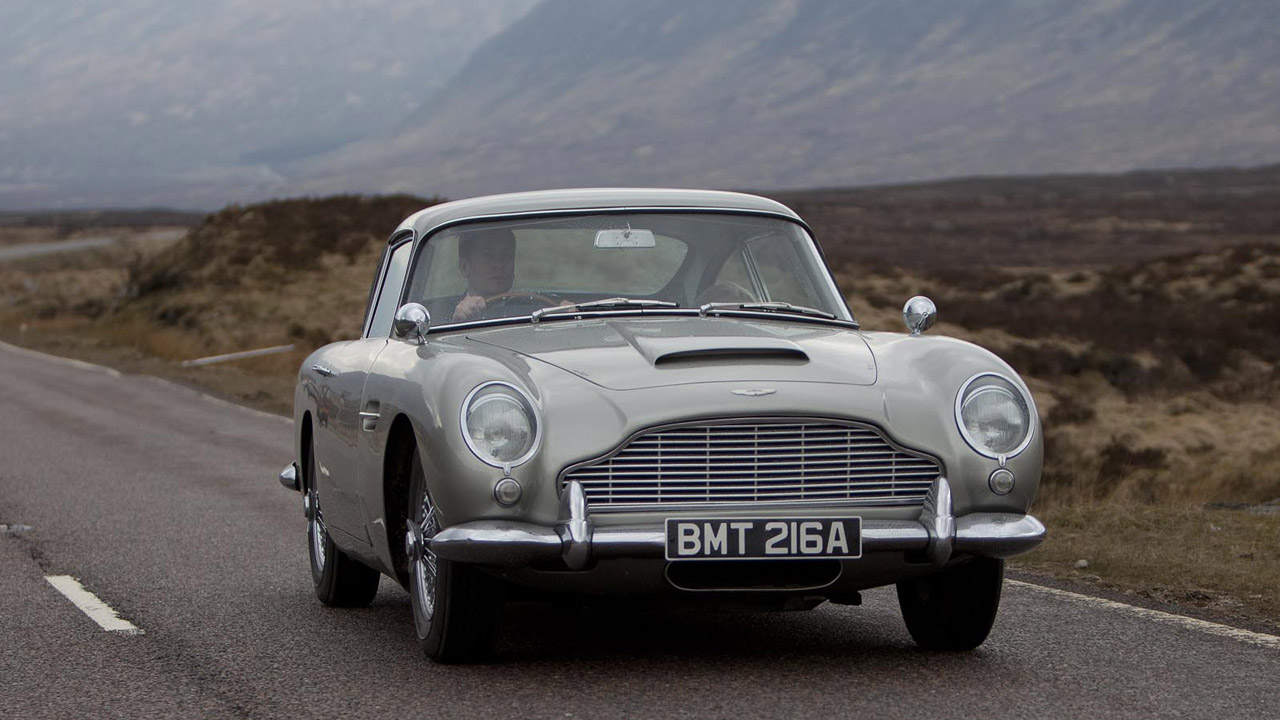 "Super-spy James Bond has had various cars throughout the years, but none have measured up to the style and class of the original. The Aston Martin DB5  is the quintessential Bond vehicle, even making an appearance in the newest Bond flick, ""Skyfall."""