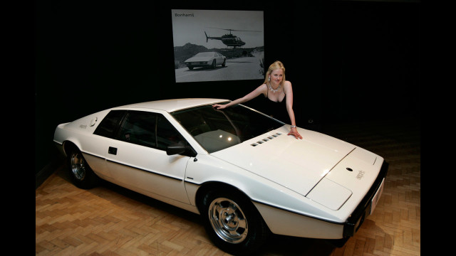 "Probably the most unique car ever driven by James Bond, the Lotus Espirit, featured in ""The Spy Who Loved Me,"" was able to turn into a fully functioning submarine when submerged in water.  The car even came equipped with torpedoes.  Q really outdid himself with this one!"