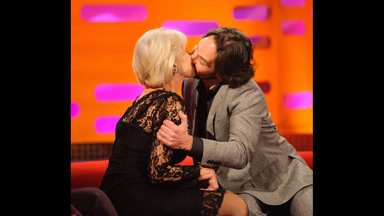 Stars getting naughty!  Paul Rudd and Helen Mirren share a snog.