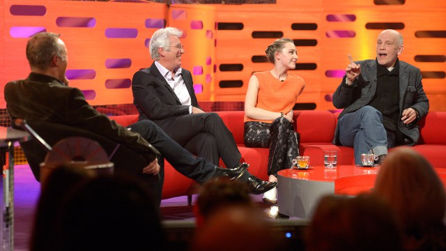Young and old collide as Richard Gere, John Malcovich, and Saoirse Rownan crowd the couches together.