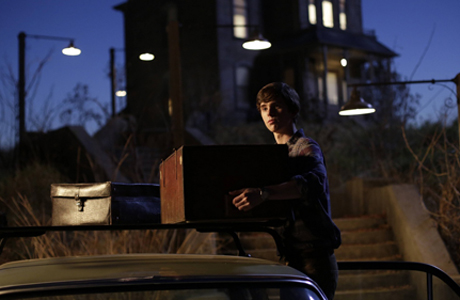 Freddie Highmore in front of the Bates Motel. (A&E)
