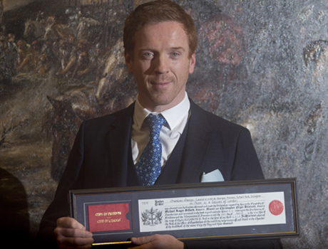 He looks well chuffed ... as he should be! Damian Lewis received the Freedom of the City of London Award. (AP)