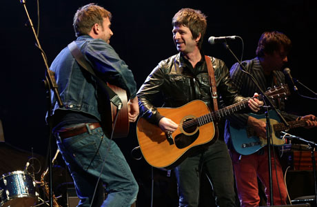 "Gallagher and Albarn perform Blur's ""Tender"" together at the Teenager Cancer Trust concert (Yui Mok/PA)"
