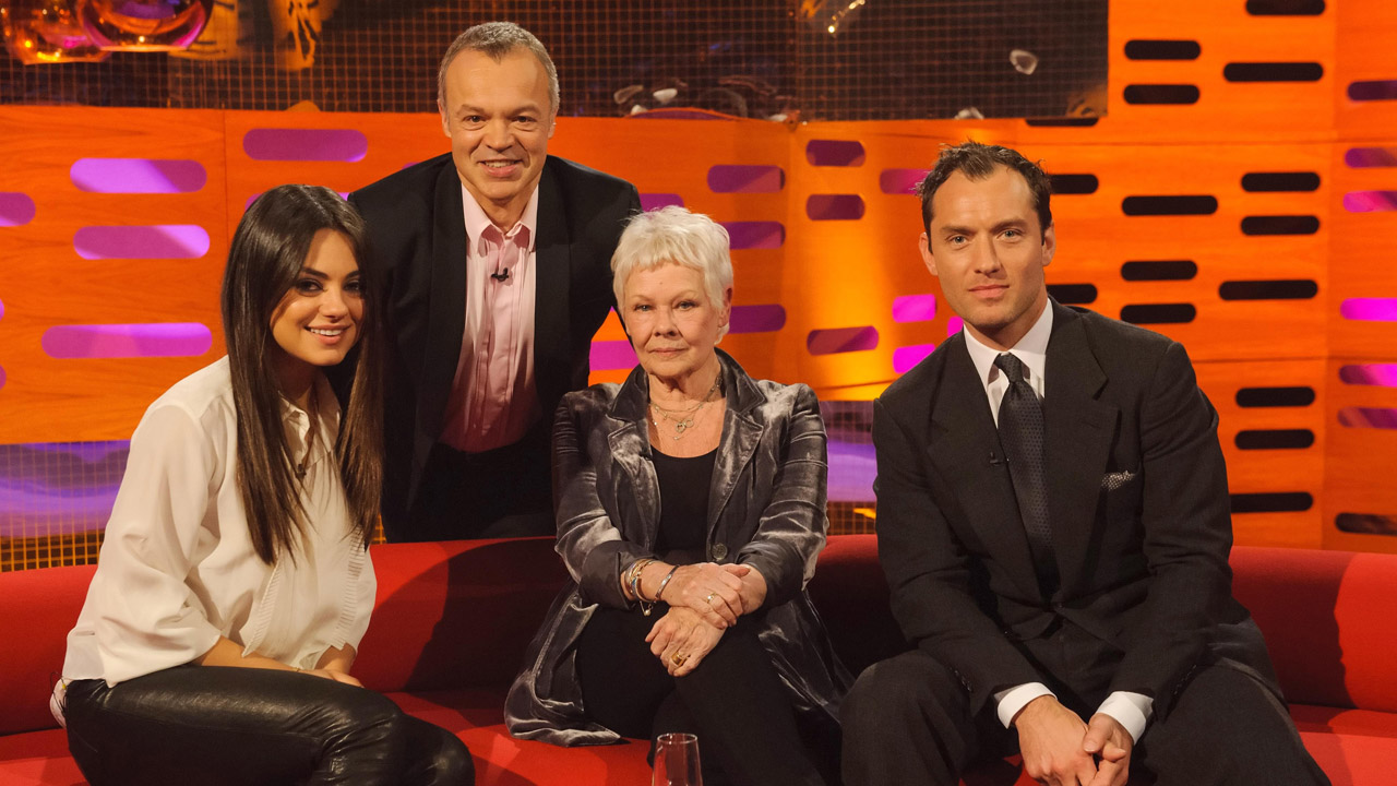 Dame Judy Dench, Mila Kunis, and Jude Laws pose for a photo.