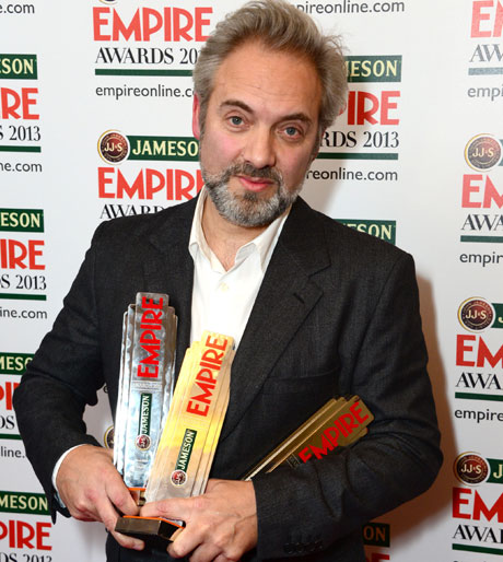 Sam Mendes clutching his three Empire awards (AP Images: Photo by Jon Furniss/Invision)
