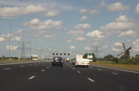 The A2 superhighway linking Amsterdam to Utrecht in the Netherlands. Notice the windmill on the right. (aswchris/YouTube)