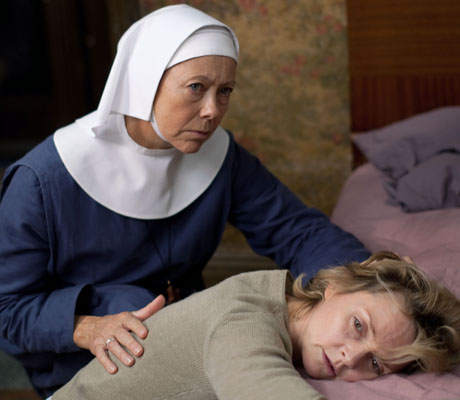 Sister Julienne consoles the ailing Nora. (BBC)