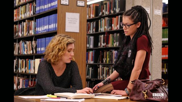 Tatiana Maslany and Evelyne Brochu filming a flirty library scene.