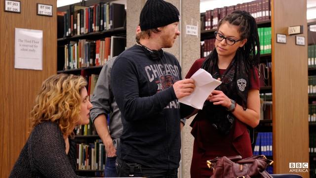 Director John Fawcett, Tatiana Maslany, and Evelyne Brochu at work in the library.