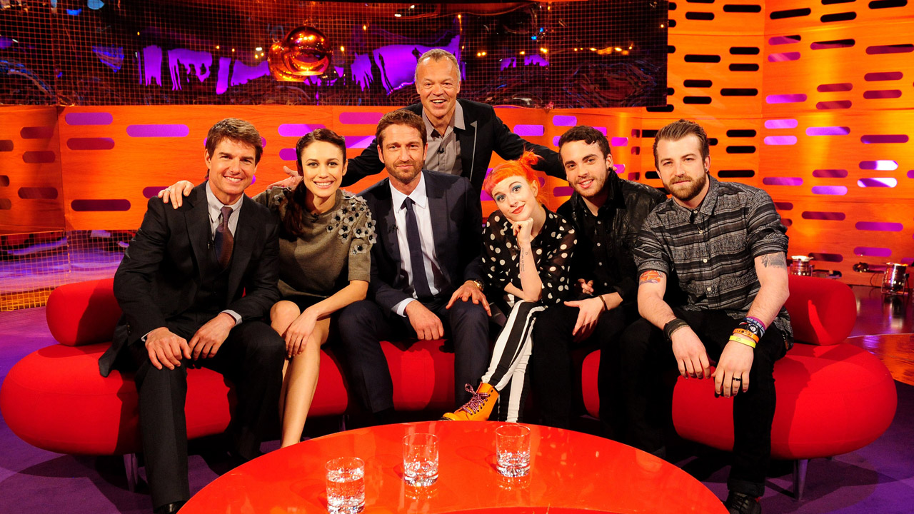 Tom Cruise, Gerard Butler, Olga Kurylenko, and the rock band Paramore kick it on the couch.