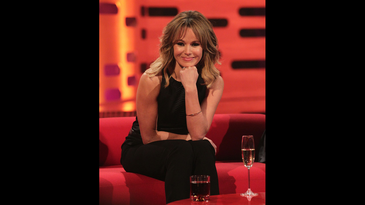 Actress Amanda Holden flashes a smile.