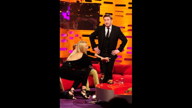 Lee Mack receiving some slightly inappropriate touching from Gwyneth and Mo.