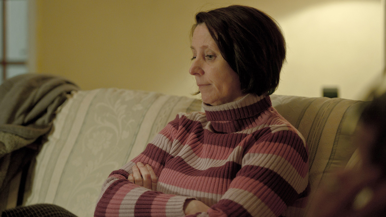 Kieren's mom worries about her son's future, and the town's reception of his return.
