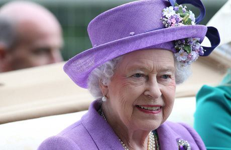 Her Majesty led the procession wearing a refined lavender hat. (AP)