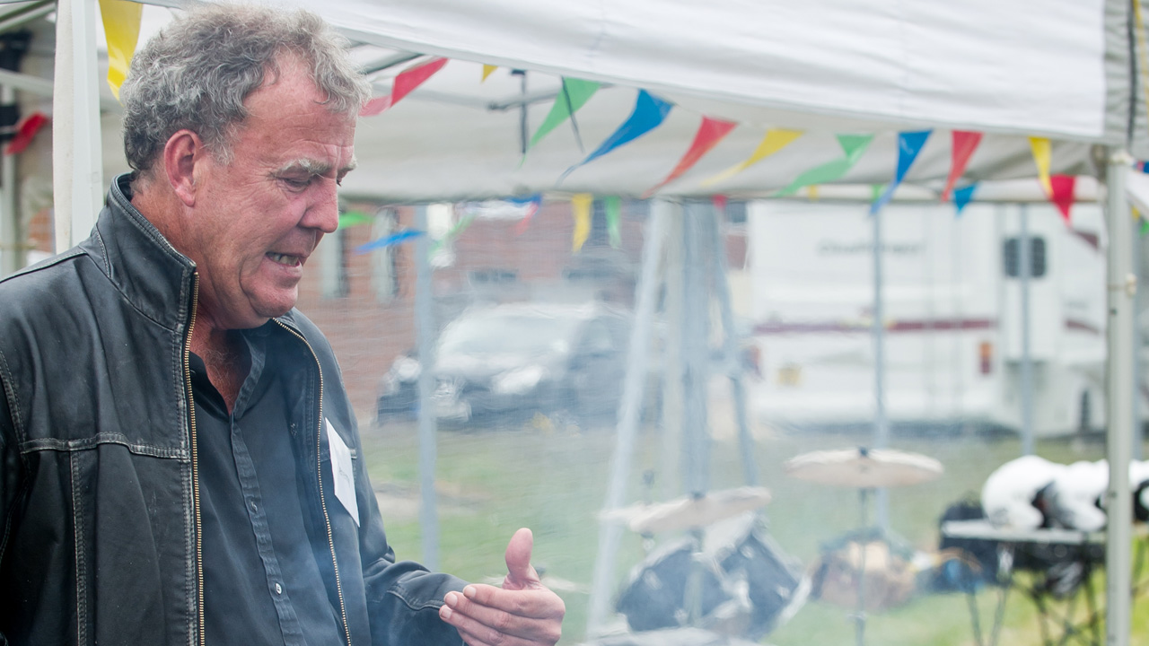Jeremy Clarkson barbecuing meat at the Reasonably Priced Car tea party