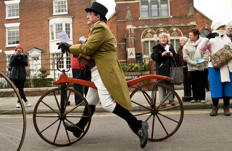 Stephen Downham, President of Pickwick Bicycle Club celebrates the bicentenary of the birth of Charles Dickens with a quick bike ride (Rex Features via AP Images)