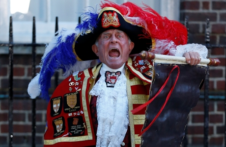 Tony Appleton, a town crier, announces the birth of the royal baby, outside St. Mary's Hospital exclusive Lindo Wing in London, Monday, July 22, 2013. Palace officials say Prince William's wife Kate has given birth to a baby boy. The baby was born at 4:24 p.m. and weighs 8 pounds 6 ounces. The infant will become third in line for the British throne after Prince Charles and William. (AP Photo/Lefteris Pitarakis)