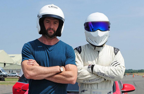 Hugh Jackman (left) and The Stig on 'Top Gear' (Photo: @RealHughJackman Twitter account.