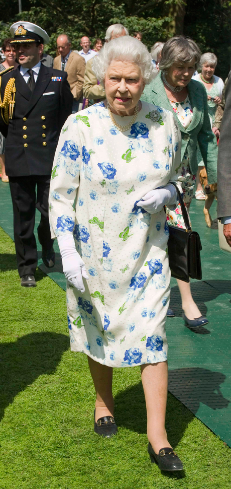 Her Majesty The Queen visiting exhibits at the Coronation Festival on July 11. (Photo: Express Newspapers via AP Images)