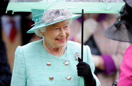 Queen Elizabeth II hosts a garden party at the Palace of Holyrood house in Edinburgh. (Photo via AP)
