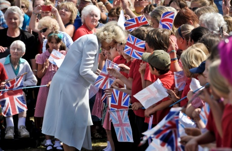 Camilla, Duchess of Cornwall is greeted by school children as she arrived in Cornwall yesterday, July 15. The Duchess and Prince Charles visit Cornwall and Devon each summer. (Photo via AP)