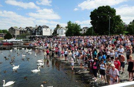 Crowds gather at the pier for the arrival of Queen Elizabeth II on Windermere pier. (Press Association via AP Images)